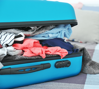 8 Tips for Creating a Glorious Guest Room Suitcase Image